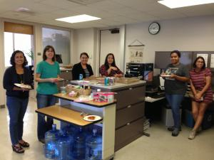 Fem Studies department gathers around pizza party